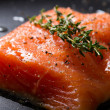 Fresh trout fillet on a frying pan — Stock Photo
