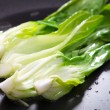 Bok choy stir fry on pan - Stock Photo