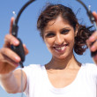 Young woman holding headphones — Stock Photo #11339178