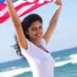 Beautiful young woman with american flag — Stock Photo