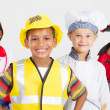 Stock Photo: Group of happy little workers in various uniforms