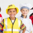 Group of happy little workers in various uniforms - Stock fotografie