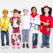 Group of children dressing in various uniforms — Stock Photo #11339620