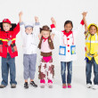 Cheerful group of kids in uniforms — Stock Photo #11339632