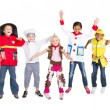 Foto Stock: Group of kids in costumes jumping up