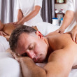 图库照片: Man and woman having massage