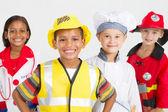 Glückliche kleine arbeitnehmergruppe in verschiedenen uniformen — Stockfoto