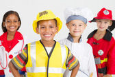 Groep van gelukkig weinig werknemers in verschillende uniformen — Stockfoto