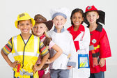 Group of kids in uniforms costumes — Stock Photo