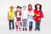 Group of children dressing in various uniforms — Stok fotoğraf