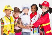 Süße kleine arbeitnehmer-teamarbeit — Stockfoto