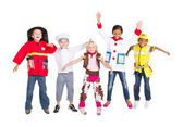 Group of kids in costumes jumping up — Stok fotoğraf