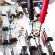 Stock Photo: Multimeter testing circuit board