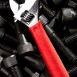 Wrench on black blots — Stock Photo
