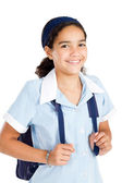 Preteen schoolgirl wearing uniform and carrying schoolbag — Stockfoto