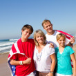 American family on beach - Stock Photo