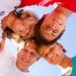Below angle of happy family embracing — Stock Photo