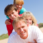 Happy family lying on beach — Stock Photo #11363852