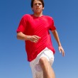 Active teen boy running on beach — Stock Photo #11363888