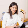 Pretty young woman holding a credit card — Stock Photo #11364163
