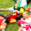 Group of soccer fans lying on grass — Stock Photo
