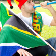 Soccer fan blowing a vuvuzela — Stock Photo #11364473