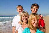 Happy family on beach — Stock Photo