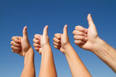Family thumbs up — Stockfoto