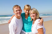 Happy mother and father pick up teenager daughter — Stock Photo
