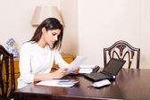 Woman working on her bills — Stock Photo