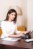 Woman working on her financial papers at home — Stock Photo