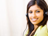 Young woman listening music with headset — Stock Photo