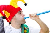 Soccer fan blowing vuvuzela — Stock Photo