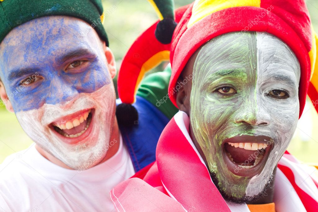 Super sports fans with face painting — Stock Photo #11364454