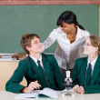 Teacher talking to students in science class — Stock Photo #11388858