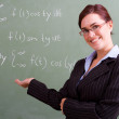 Attractive young female teacher — Stock Photo