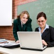 High school teacher and student in classroom — Stock Photo