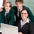 Stock Photo: High shcool teacher and students
