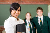 Middle school teacher and students in classroom — Stock Photo