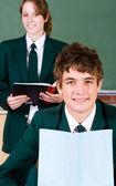 High school students reading books — Stock Photo