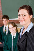 Friendly high school teacher and students — Stock Photo