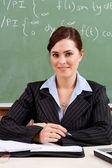 Female school teacher in classroom — Stock Photo