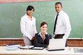 Group of young school teachers in classroom — Stock Photo