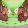 African american man with handcuffs - Stock Photo