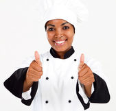 Female african american chef thumbs up — Stock Photo