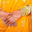 Indian wedding bride hands with henna - Stock Photo