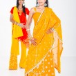 Young indian women in traditional sari in studio — Stock Photo #11938420