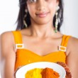Beautiful indian woman presenting spices — Stock Photo