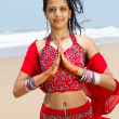Young indian woman in traditional sari on beach praying — Foto Stock