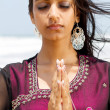 Indian woman praying — Stock Photo